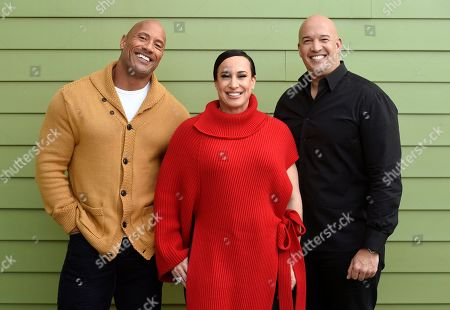 """Dwayne Johnson, Dany Garcia, Hiram Garcia. Dwayne Johnson, left, and Dany Garcia, center, co-founders and co-CEOs of Seven Bucks Productions, and her brother Hiram Garcia, the company's president of production, pose together during the 2019 Sundance Film Festival, in Park City, Utah. Johnson put on his independent film producer hat to make his latest film, """"Fighting With My Family"""