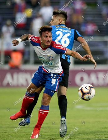 Stock Picture of Martin Rivas of Uruguay's Liverpool, back, fights for the ball with Artur of Brazil's Bahia, front, during a Copa Sudamericana soccer game in Montevideo, Uruguay