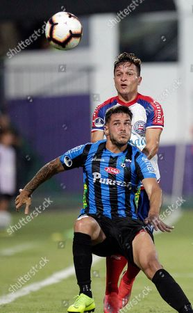 Martin Rivas of Uruguay's Liverpool, front, fights for the ball with Artur of Brazil's Bahia during a Copa Sudamericana soccer game in Montevideo, Uruguay