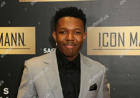 Stock Picture of Denzel Whitaker arrives at the 7th Annual ICON MANN Pre-Oscar Dinner at the Waldorf Astoria, in Beverly Hills, Calif