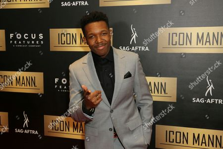 Denzel Whitaker arrives at the 7th Annual ICON MANN Pre-Oscar Dinner at the Waldorf Astoria, in Beverly Hills, Calif