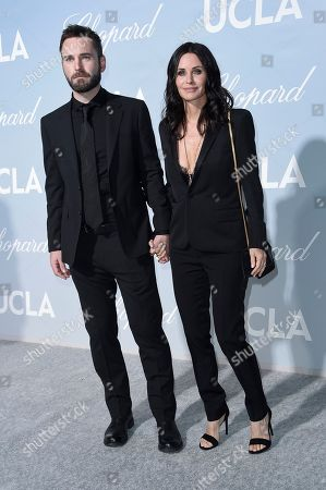 Courteney Cox, Johnny McDaid. Courteney Cox, left, and Johnny McDaid attend the 2019 Hollywood for Science Gala, in Los Angeles