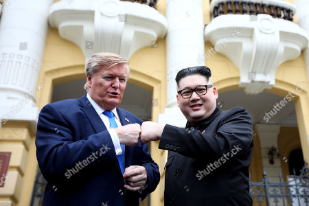 Kim Jong-un impersonator Howard X (R) and Donald Trump impersonator Dennis Alan (L) pose for photos outside the Opera House in Hanoi, Vietnam, 22 February 2019. The second summit between US President Donald Trump and North Korean leader Kim Jong-un will take place in Hanoi on the 27 and 28 February 2019.
