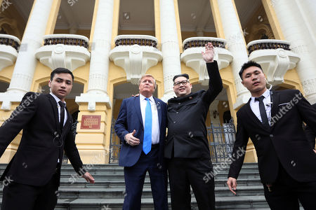 Kim Jong-un impersonator Howard X (C, right) and Donald Trump impersonator Dennis Alan (C, left) pose for photos outside the Opera House in Hanoi, Vietnam, 22 February 2019. The second summit between US President Donald Trump and North Korean leader Kim Jong-un will take place in Hanoi on the 27 and 28 February 2019.