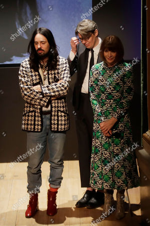 American Vogue editor-in-chief Anna Wintour, right, Gucci creative director Alessandro Michele, left, and curator Andrew Bolton stand during the presentation of this year's Costume Institute exhibition titled ''Camp: Notes on Fashion,'' at the Teatro Gerolamo, in Milan, Italy, . The exhibition will be shown at the Metropolitan Museum of Art of New York, from May 9-Sept. 8, 2019