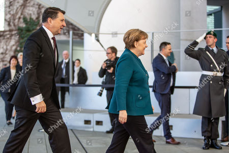German Chancellor Angela Merkel (R) welcomes the President of Latvia Raimonds Vejonis (L) at the Chancellery, in Berlin, Germany, 22 February 2019. Vejonis is on an official visit to Germany.