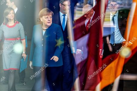 German Chancellor Angela Merkel makes her way to meet the President of Latvia Raimonds Vejonis (not pictured) at the Chancellery, in Berlin, Germany, 22 February 2019. Vejonis is on an official visit to Germany.