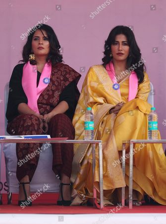 Bollywood actors Richa Chadda, left, and Chitrangada Singh participate in a rally to highlight issues of sexual violence in New Delhi, India, . The rally marked the culmination of, what a press release says is, a 10,000-kilometer long march across India to raise awareness on sexual violence, ending stigma against victims and the barriers women and children face in accessing justice