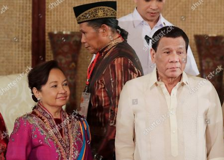 Abdulla Macapaar, Rodrigo Duterte, Gloria Macapagal Arroyo. Abdullah Macapaar, center, who uses the nom de guerre Commander Bravo, walks behind President Rodrigo Duterte, right, and House Speaker Gloria Macapagal Arroyo following oath-taking ceremony for the creation of the Bangsamoro Transition Authority or BTA at the Presidential Palace in Manila, Philippines . The Muslim rebels will serve as administrators of a new Muslim autonomous region in a delicate milestone to settle one of Asia's longest-raging rebellions. Several commanders, including Commander Bravo, long wanted for deadly attacks were given safety passes to be able to travel to Manila and join the ceremony