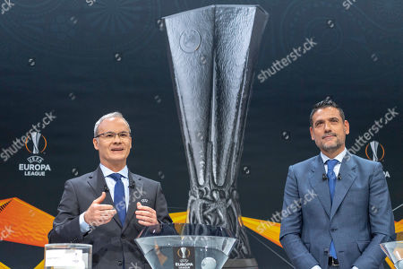 UEFA deputy secretary general Giorgio Marchetti, left, and former Spanish football player Andres Palop, right, ambassador for the UEFA Europa League, speak during the drawing of the games for the Europa League 2018/19 Round of 16, at the UEFA headquarters in Nyon, Switzerland, Friday, February 22, 2019.