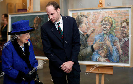 Artist Harry Parker explains his drawings to Britain's Queen Elizabeth II, Patron, The Royal Army Chaplains' Department, as she attends a service to celebrate the centenary of the granting by King George V of the prefix 'Royal' to the department, at The Guards' Chapel, Wellington Barracks in London