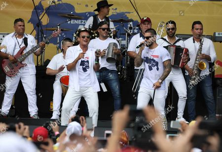 Colombian singers Silvestre Dangond, left, and Maluma, right, sing during the Venezuela Aid Live concert on the Colombian side of Tienditas International Bridge near Cucuta, Colombia, on the border with Venezuela