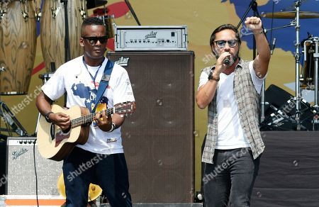 Argentine singer Diego Torres, right, performs during the Venezuela Aid Live concert on the Colombian side of the Tienditas International Bridge near Cucuta, Colombia, on the border with Venezuela