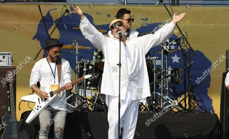 Spanish singer Miguel Bose performs during the Venezuela Aid Live concert on the Colombian side of the Tienditas International Bridge near Cucuta, Colombia, on the border with Venezuela