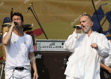 Spanish singer Miguel Bose, right, sings with one of his backup singers during his performance in the Venezuela Aid Live concert on the Colombian side of the Tienditas International Bridge near Cucuta, Colombia, on the border with Venezuela