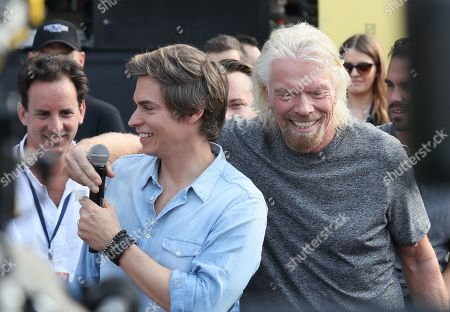 British businessman and event organizer Richard Branson (R) and Venezuelan Singer Carlos Baute (L) speak before the Venezuela Aid Live concert in Cucuta, Colombia, 22 February 2019. Some 250,000 people are expected to attend the 'Venezuela Aid Live' music event, an event that seeks to raise funds for essential humanitarian aid for Venezuela.