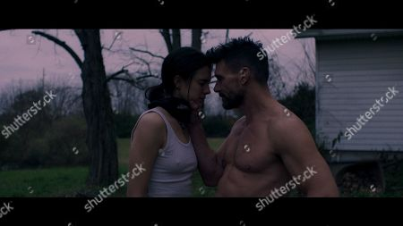 Stock Picture of Sarah Margaret Qualley as Delia Angus and Frank Grillo as Chainsaw Angus