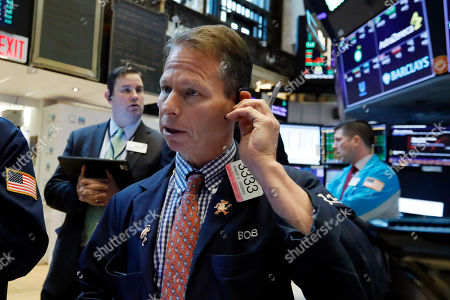 Trader Robert Charmak works on the floor of the New York Stock Exchange, . Stocks are opening higher on Wall Street, led by gains in technology and health care companies