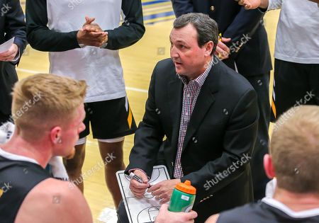 Fort Hays State Head Coach Mark Johnson talks with his team during a basketball game between the Fort Hays State Tigers and the Central Oklahoma Bronchos at Hamilton Field House in Edmond, OK
