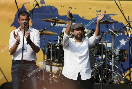 """Juan Luis Guerra performs at the Venezuela Aid Live concert at the Tienditas International Bridge on the outskirts of Cucuta, Colombia, on the border with Venezuela. British billionaire Richard Branson organized the mega concert, which features dozens of Latin musicians performing on a giant stage on one side of what Colombian authorities have renamed the """"Unity"""" bridge"""
