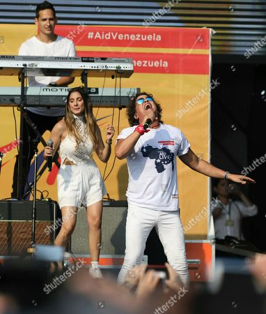 "Carlos Vives performs at the ""Live Aid Venezuela"" concert at the Tienditas International Bridge on the outskirts of Cucuta, Colombia, on the border with Venezuela. British billionaire Richard Branson organized the mega concert, which features dozens of Latin musicians performing on a giant stage on one side of what Colombian authorities have renamed the ""Unity"" bridge"