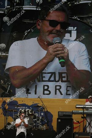 "Ricardo Montaner performs at the ""Live Aid Venezuela"" concert at the Tienditas International Bridge on the outskirts of Cucuta, Colombia, on the border with Venezuela. British billionaire Richard Branson organized the mega concert, which features dozens of Latin musicians performing on a giant stage on one side of what Colombian authorities have renamed the ""Unity"" bridge"