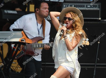 Mexican Singer Paulina Rubio performs during the Venezuela Aid Live concert at the Tienditas border bridge, in Cucuta, Colombia, 22 February 2019. The concert 'Venezuela Aid Live', which was promoted by the billionaire Richard Branson and has the participation of at least 32 artists from a dozen countries, aims to promote humanitarian aid to support Venezuelans affected by the crisis in their country and raise 100 million dollars for the needy.