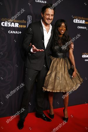 Vincent Cerutti and Hapsatou Sy arrive for the 44th annual Cesar awards ceremony held at the Salle Pleyel concert hall in Paris, France, 22 February 2019.