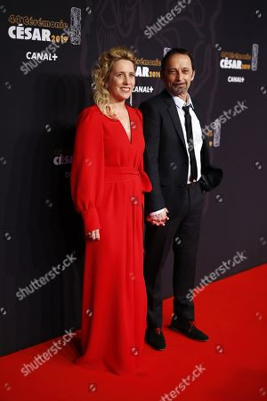 Andrea Bescond (L) and Eric Metayer (R) arrive for the 44th annual Cesar awards ceremony held at the Salle Pleyel concert hall in Paris, France, 22 February 2019.