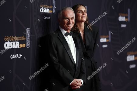 Alain Terzian (L) and wife Brune De Margerie arrive for the 44th annual Cesar awards ceremony held at the Salle Pleyel concert hall in Paris, France, 22 February 2019.