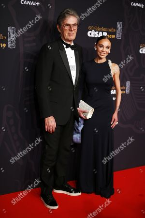 Stock Photo of French businessman Dominique Desseigne (L) and partner Alexandra Cardinale (R) arrive for the 44th annual Cesar awards ceremony held at the Salle Pleyel concert hall in Paris, France, 22 February 2019.