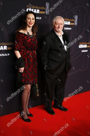 Niels Arestrup (R) and guest arrive for the 44th annual Cesar awards ceremony held at the Salle Pleyel concert hall in Paris, France, 22 February 2019.