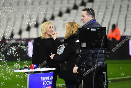 Sky Sports Presenter Kelly Cates has some lip gloss applied before going on air