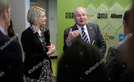 Robert DeLeo, Emily Reichert. Massachusetts House Speaker Robert DeLeo, right, gestures prior to a tour at Greentown Labs in Somerville, Mass., . DeLeo has unveiled a plan to invest $1 billion over the next 10 years aimed at helping local cities and towns adopt new technologies designed to cut greenhouse gas emissions, strengthen infrastructure projects and reduce municipal costs. At left is Emily Reichert, CEO of Greentown Labs