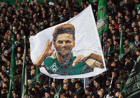 Bremen supporters wave a flag depicting Peruvian striker Claudio Pizarro before the German Bundesliga soccer match between Werder Bremen and VfB Stuttgart in Bremen, Germany, 22 February 2019.