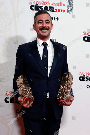 French director Xavier Legrand poses with his Best film award and Best Original Screenplay award for 'Jusqu'a la garde' (Custody) during the 44th Cesar Film Awards ceremony, in Paris