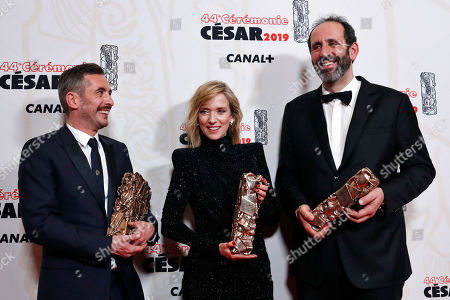 Stock Image of French director Xavier Legrand, left, poses with his Best film award and Best Original Screenplay award, French actress Lea Drucker, center, holds his Cesar best Actress award, and French producer Alexandre Gavras, right, for 'Jusqu'a la garde' (Custody) at the 44th Cesar Film Awards ceremony, in Paris