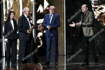 Olivier Baroux (C) receives the Public Award for the movie 'Les Tuches 3' from Kad Merad and his father during the 44th annual Cesar awards ceremony held at the Salle Pleyel concert hall in Paris, France, 22 February 2019.