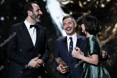 Xavier Beaugrand (R) and Alexandre Gavras (L) receive the Best Movie award for 'Jusqu'a la Garde' from Kristin Scott Thomas during the 44th annual Cesar awards ceremony held at the Salle Pleyel concert hall in Paris, France, 22 February 2019.