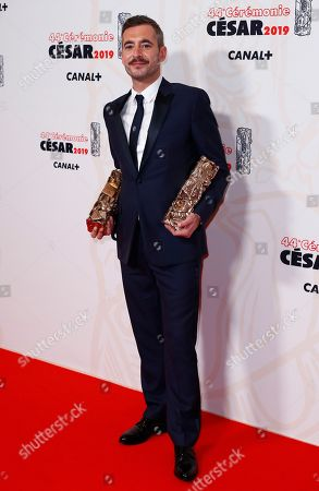 Stock Picture of Xavier Legrand poses with the Best film award and Best Original Screenplay award for 'Jusqu'a la garde' during the 44th annual Cesar awards ceremony held at the Salle Pleyel concert venue in Paris, France, 22 February 2019.