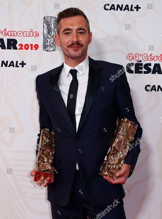 Xavier Legrand poses with the Best film award and Best Original Screenplay award for 'Jusqu'a la garde' during the 44th annual Cesar awards ceremony held at the Salle Pleyel concert venue in Paris, France, 22 February 2019.