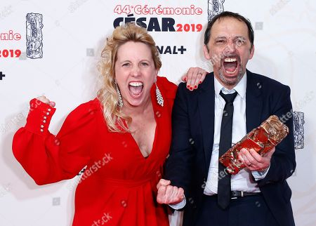 Stock Image of Andrea Bescond and French actor and director Eric Metayer pose with the Best Adaptation award for 'Les Chatouilles' during the 44th annual Cesar awards ceremony held at the Salle Pleyel concert venue in Paris, France, 22 February 2019.