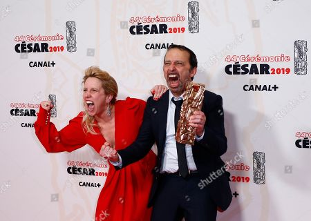 Stock Photo of Andrea Bescond and French actor and director Eric Metayer pose with the Best Adaptation award for 'Les Chatouilles' during the 44th annual Cesar awards ceremony held at the Salle Pleyel concert venue in Paris, France, 22 February 2019.