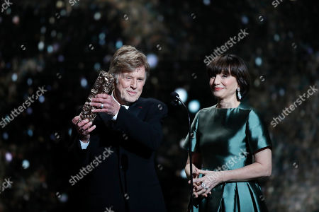 Robert Redford, Kristin Scott Thomas. Actor and director Robert Redford, left, receives an honorary Cesar award from actress Kristin Scott Thomas during the 44th Cesar Film Awards ceremony, in Paris