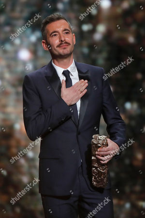 Writer Xavier Legrand receives his Cesar best Screenplay award for the film 'Custody during the 44th Cesar Film Awards ceremony, in Paris