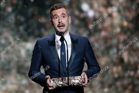 Stock Image of Director Xavier Legrand receives his Cesar best Film award for the film 'Custody' during the 44th Cesar Film Awards ceremony, in Paris