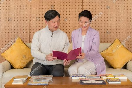 Naruhito, Masako. In this Feb. 17, 2019, photo provided by the Imperial Household Agency of Japan, Japan's Crown Prince Naruhito and Crown Princess Masako read the information on the national youth book report competition at their residence Togu Palace in Tokyo. Naruhito celebrates his 59th birthday on