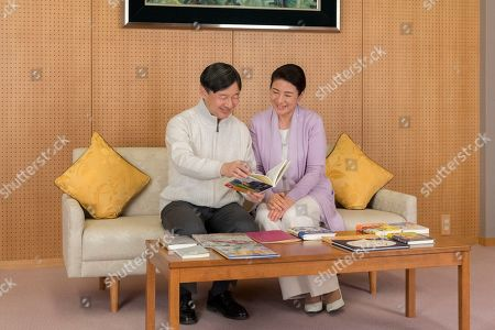 Naruhito, Masako. In this Feb. 17, 2019 photo provided by the Imperial Household Agency of Japan, Japan's Crown Prince Naruhito and Crown Princess Masako read the information on the national youth book report competition at their residence Togu Palace in Tokyo. Naruhito celebrates his 59th birthday on