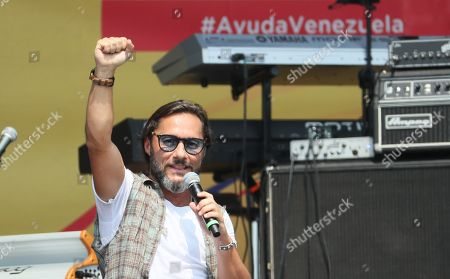 Stock Photo of Singer Diego Torres performs on stage during the Aid Live concert, funded by British billionaire Richard Branson, at the Tienditas border bridge in Cucuta, Colombia, 22 February 2019.