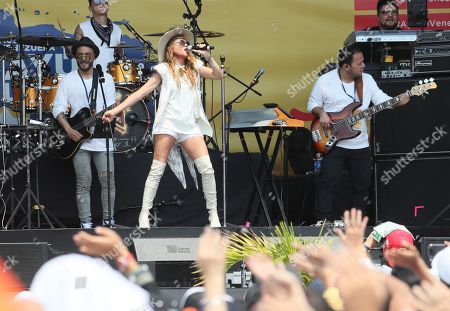 Mexican singer Paulina Rubio performs on stage during the Aid Live concert, funded by British billionaire Richard Branson, at the Tienditas border bridge in Cucuta, Colombia, 22 February 2019.